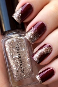Dark red and gold glitter. Each nail different.