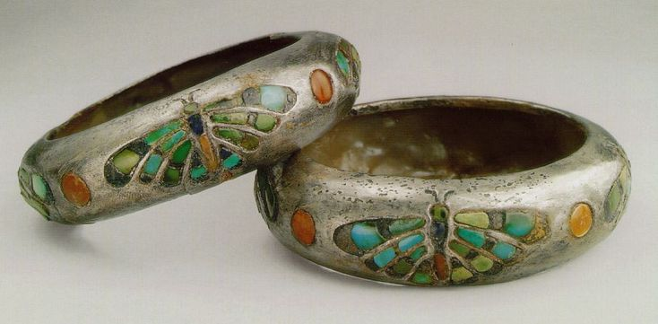 ca. 2,500 BCE. Some of the earliest silver objects unearthed in Egypt are this rare pair of silver bracelets. inlaid with semi-precious stones in the form of a dragonfly. From the tomb of Queen Hetpt-heres 1. 4th Dynasty