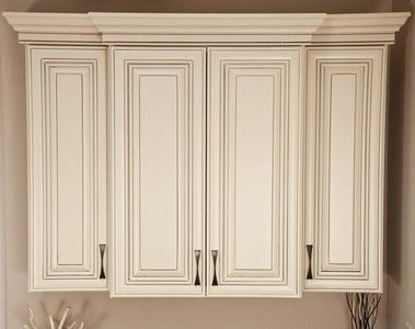 This Vanilla Créme paint with a Van Dyke Brown glaze cabinet is perfect for kitchens where the customer is looking for a bright and open look. The Raleigh, like our Charlotte kitchen cabinet design, includes a classic raised panel, full overlay door.