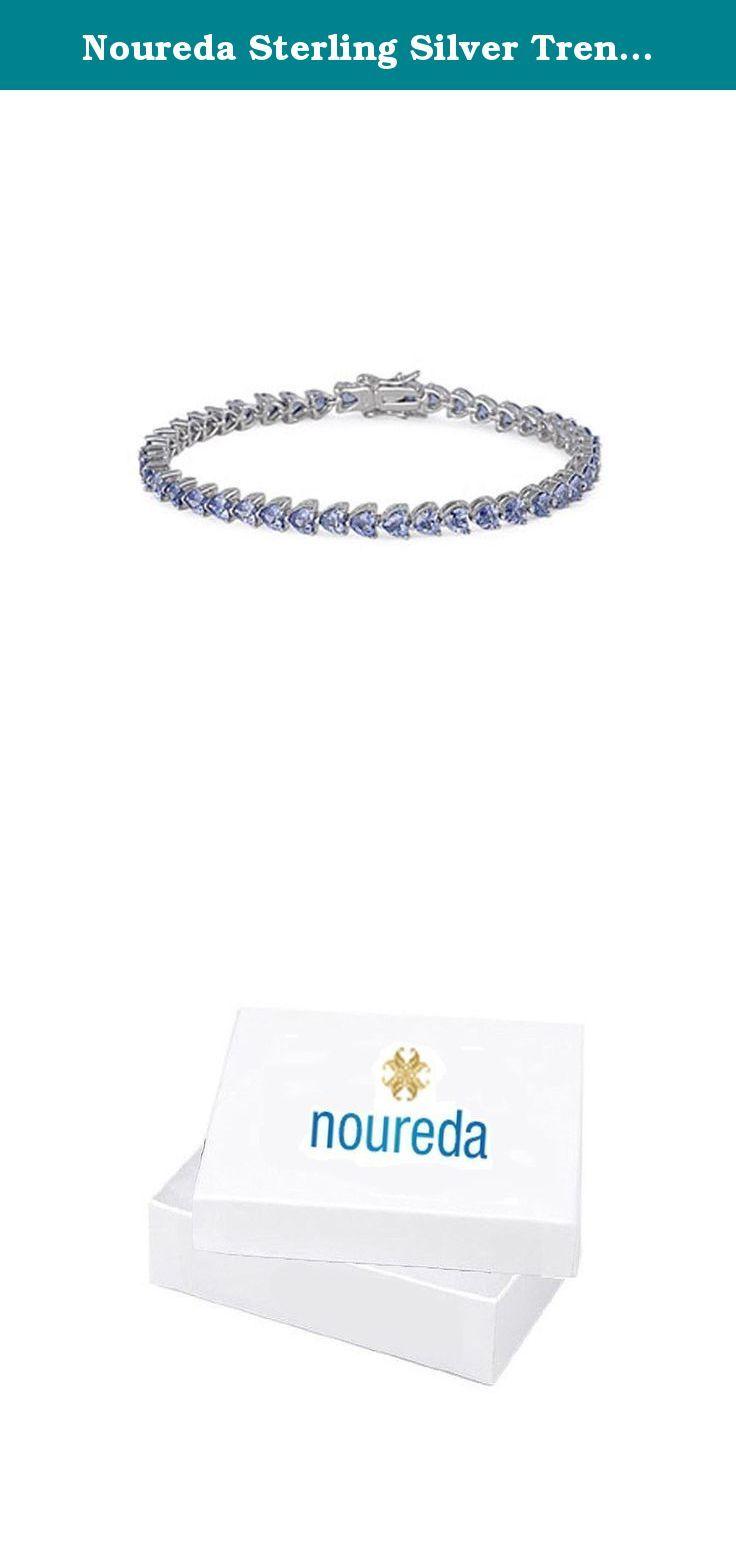 "Noureda Sterling Silver Trendy Heart Prong Set with Tanzanite Cz Tennis Bracelet, Length of 7.25"". Noureda Sterling Silver Trendy Heart Prong Set with Tanzanite Cz Tennis Bracelet, Length of 7.25""."