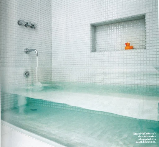 """""""Invisible"""" tub. Made from a thick sheet of glass inserted between the two tile walls."""