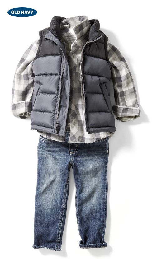 Keep your mini mountain-man warm this fall by layering a navy puffer vest over a buffalo-plaid shirt and dark denim jeans.