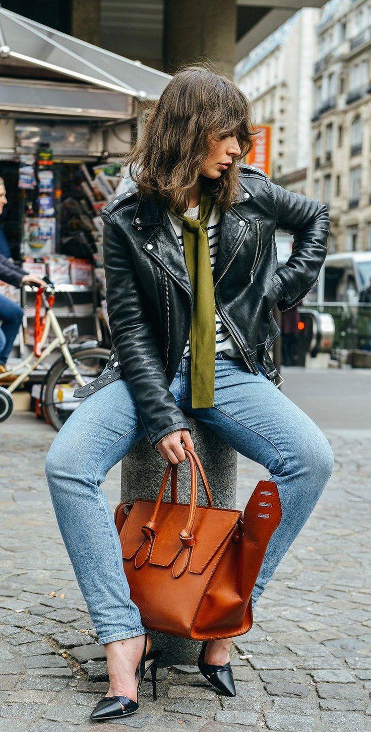 Flared jeans, striped top, green scarf, leather moto jacket