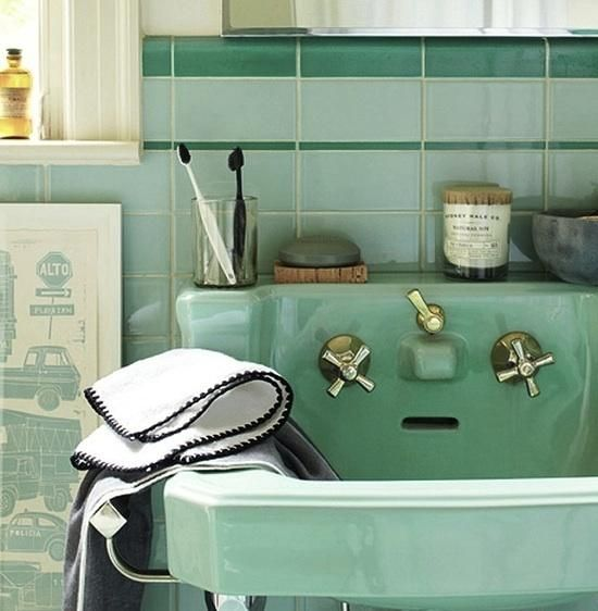 I love mint green in bathrooms, this sink is cool and boasts lovely original taps.  {I put this exact same sink - 1948?- in the tybee house in white - the cast spout is a favorite feature}