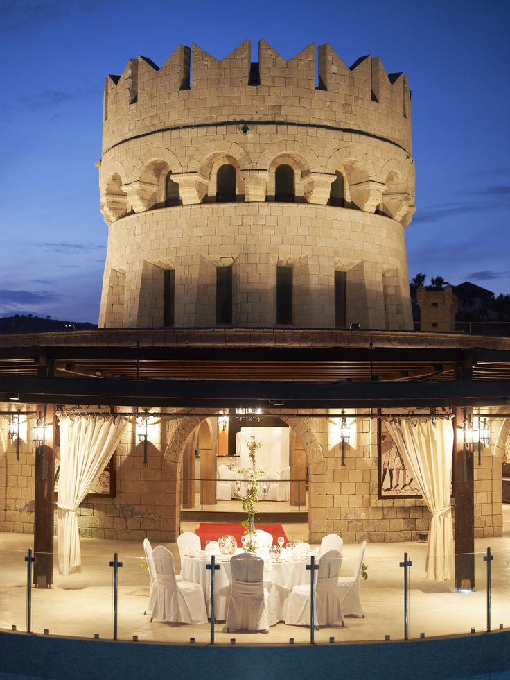 "Castello  Built following the architecture of the medieval towers of the old town of Rhodes, ""Castello"" is a unique venue with an exceptional atmosphere and aesthetic. Among the trees of the garden of Esperos Palace, has its own independent outdoor space, and a unique interior that can accommodate any type of event, wedding reception, cocktail party always with the care and diligence of the people of Esperos Resorts."