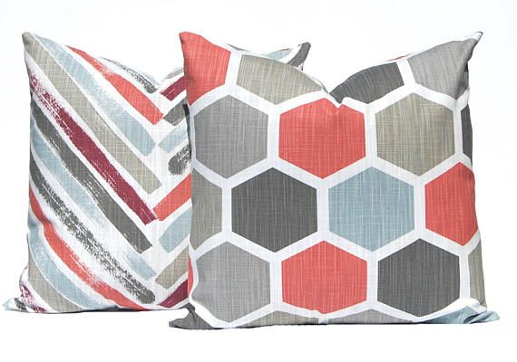 Designer pillow covers with four coordinating prints. This new fabric line is a heavy weight slub cotton canvas (linen like appearance) and guaranteed to add a designer touch to your decor. This special collection includes the colors of brick red, dusty blue, light and dark gray on a