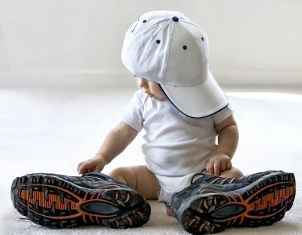 Cutest photo idea baby boy daddy's shoes. We'll have to do this, but with daddy's boots. :)