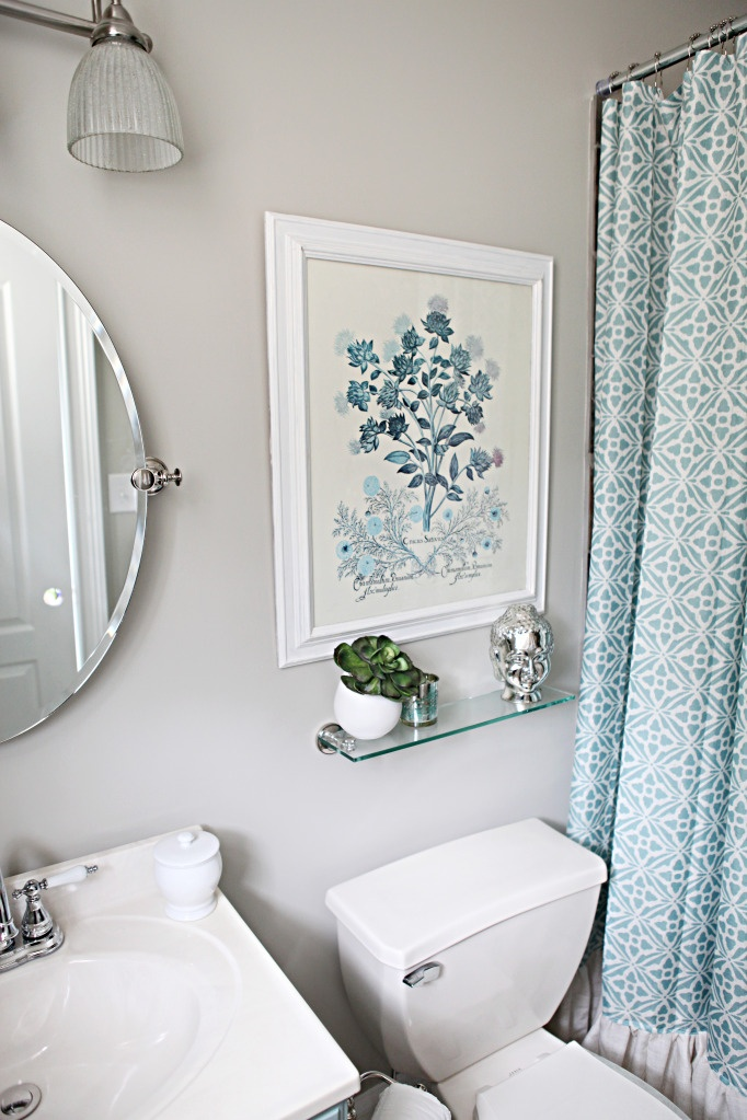 Above toilet & great idea to add ruffle to shower curtain   – Master Bath