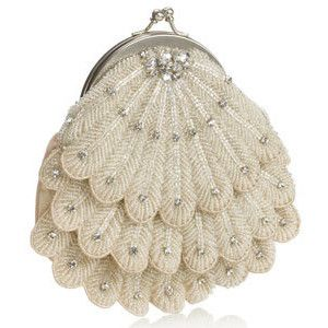 So pretty, 1920's art deco style My Grandma had one just like this and another shaped as a seashell made from pearls!!!