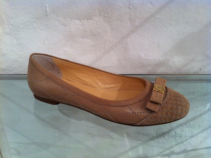 Tan pumps by Francesca.
