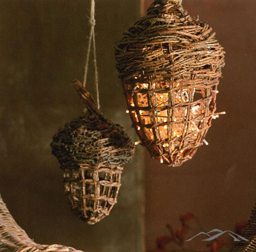 Willow Acorn. Hand-woven willow forms openwork hanging acorns for autumnal flair. Open the bird house-style door and fill with a strand of lights to make a lamp.