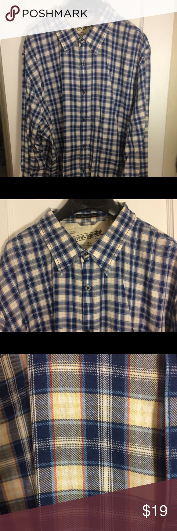 Artful Dodger button down shirt 4XL Artful Dodger blue plaid button down shirt. Size 4XL. Back of shirt elbows has off white patches  (Fits like 3XL ) Length from top of collar to bottom of shirt is 34'. Chest from armpit to armpit 26' Artful Dodger Shirts Dress Shirts