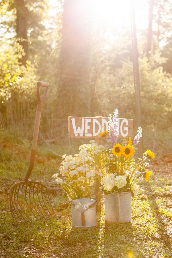 watering cans & sunflowers ~ perfect for a farm or barn wedding