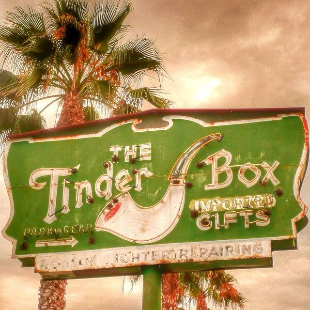 The Tinder Box, a chain of tobacco smoke shops in L.A. especially in the 1950s and 1960s. The palm tree in the background is appropriate...