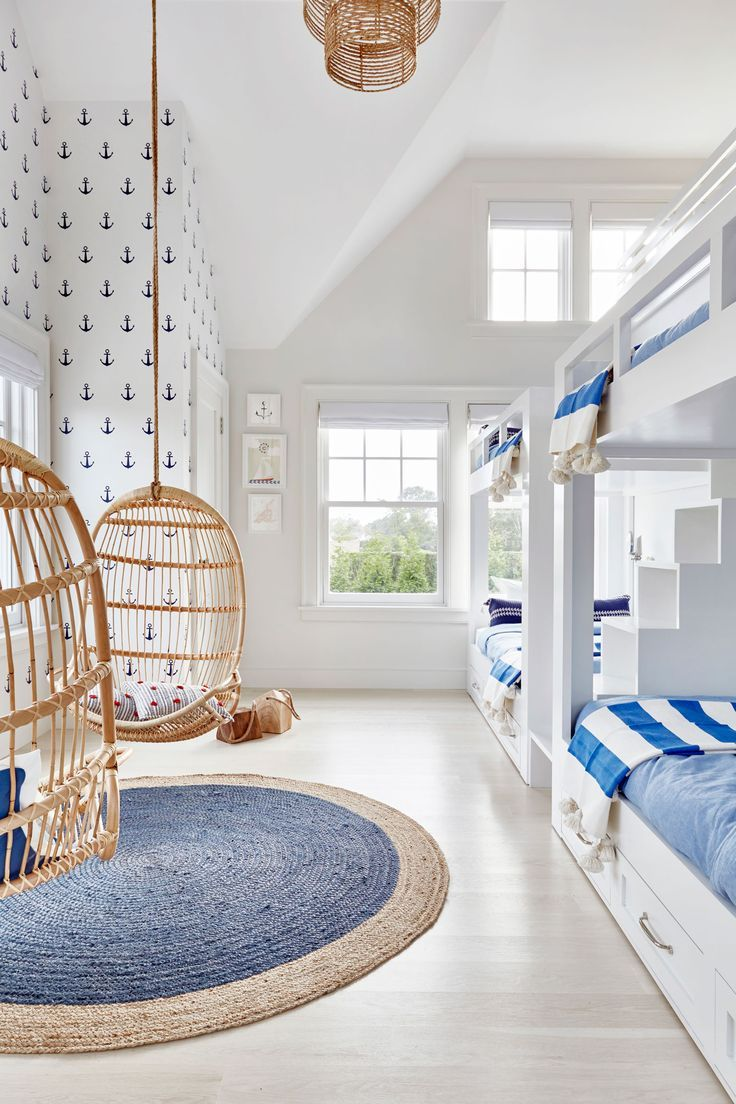 A nautical kids room | Hanging Rattan Chairs via Serena & Lily | Image via Chango & Co