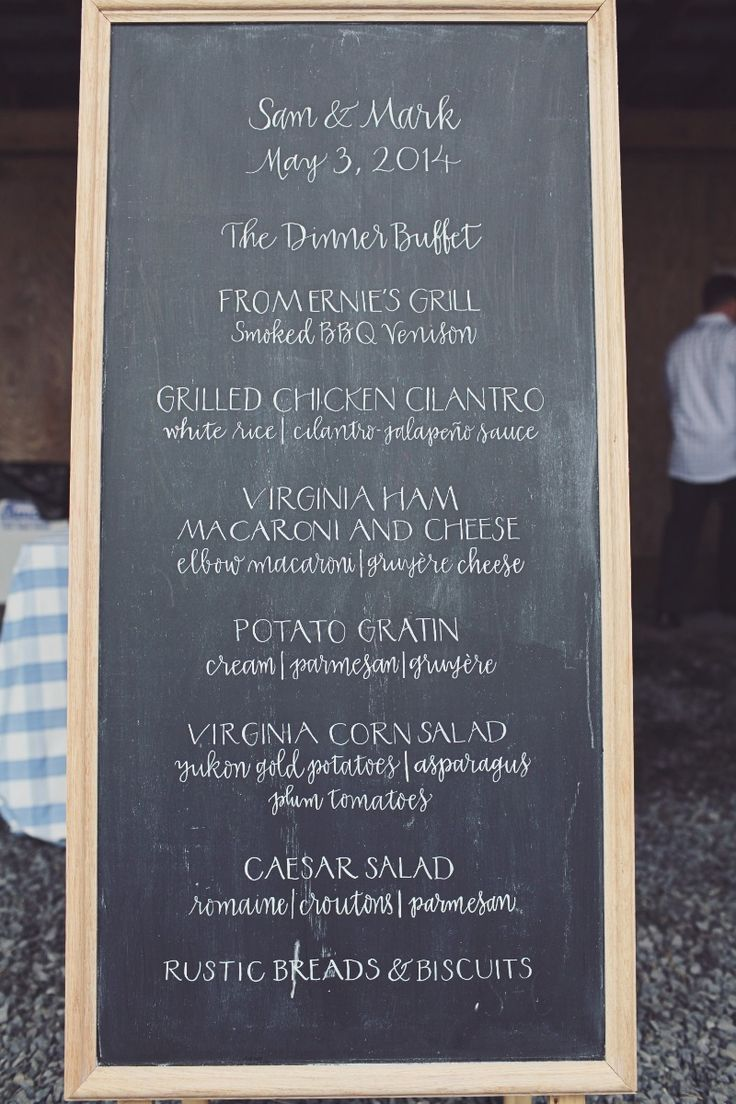 Chalkboard calligraphy for a wedding dinner menu sign by Meant To Be Calligraphy. Photo by Natalie Lane.