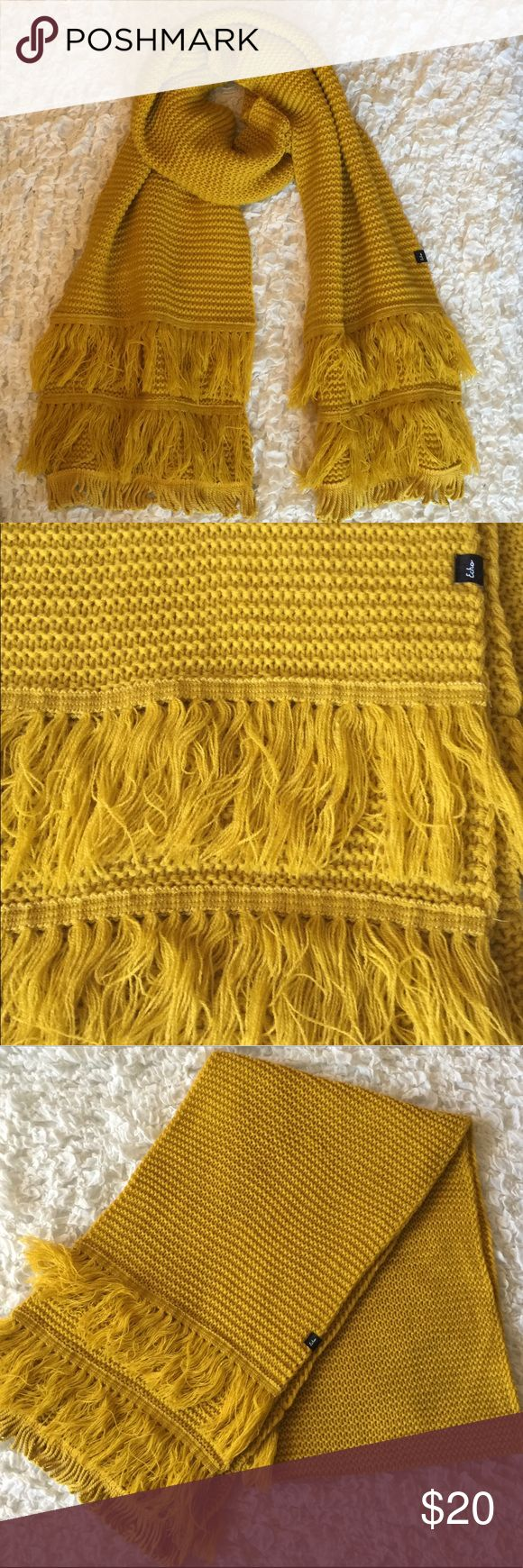 Echo Fringy Muffler Scarf Add a pop of color to your outfit with this cozy and warm Echo Scarf in mustard yellow. Perfect for the fall weather.   Measures 12in wide and 82 in long. Does have a few minor snags on the back side of the scarf that aren't noticeable from the front. Echo Accessories Scarves & Wraps