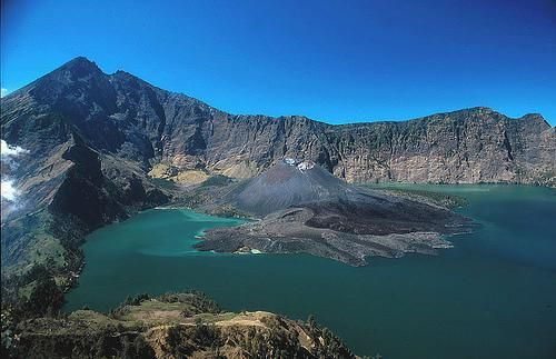 Mount Rinjani, West Nusa Tenggara | Eruptions within the caldera have formed a baby mountain in Segara Anak.