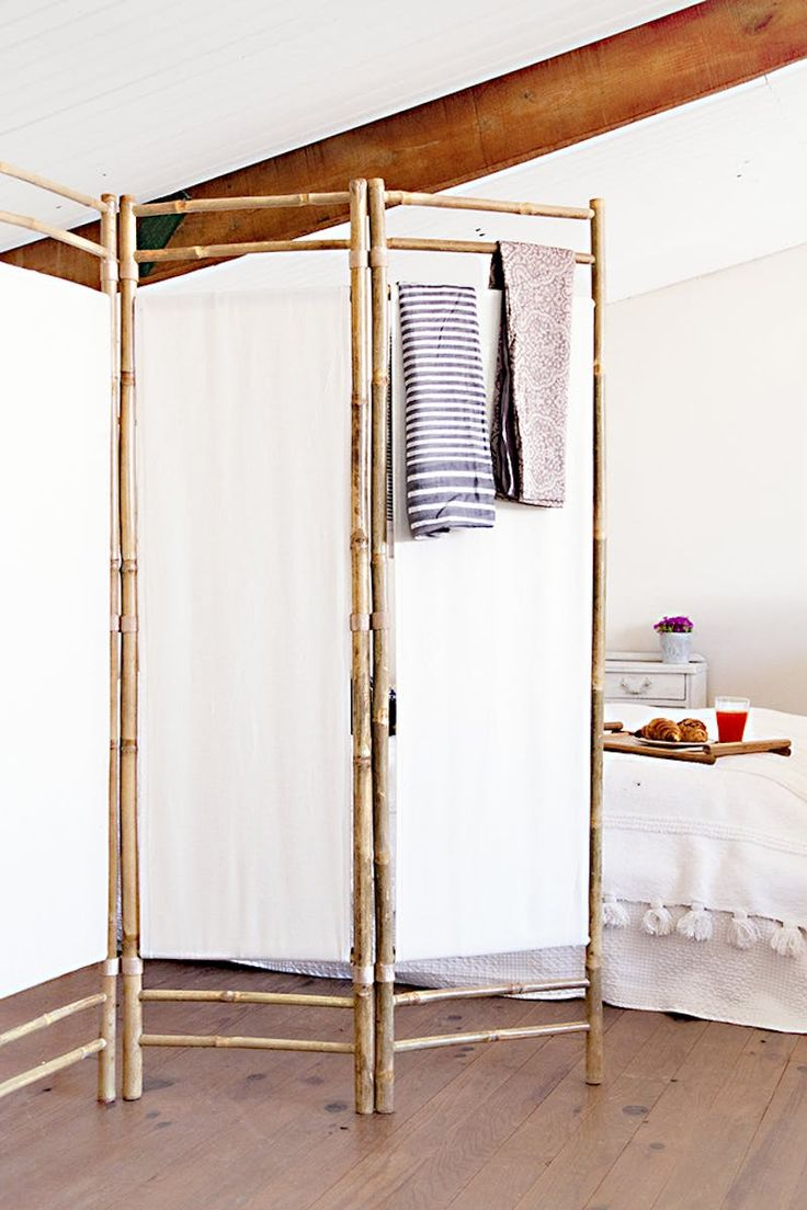 """Folding screens automatically seem to turn any bedroom into what can only be described as a """"boudoir,"""" and the bamboo-and-fabric one above from Sweet Harmonie also infuses the room with a laid-back tropical vibe. The screen above was found in the home decor shop Muy Mucho, but I'm also imagining this would make a fun DIY project (by the way, did you know that Home Depot sells bamboo poles?)."""