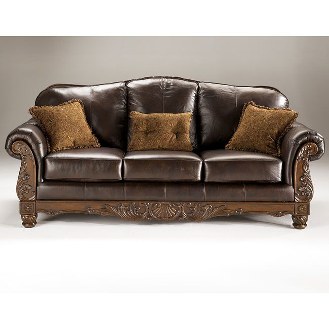 Leather Sofa With Carved Wood Trim | Shapeyourminds.com
