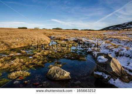 Swamps in Late Autumn with Snow and Rocks in Sunset - Krkonose, Czech Republic by ZM_Photo, via Shutterstock