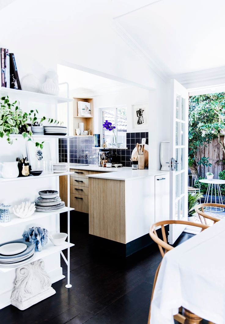 This bright and airy kitchen and dining room opens onto a lush courtyard in Sydney Interiors stylist Kristen Bookallil's home in Bondi. Photography: Maree Homer   Styling: Kristen Bookallil
