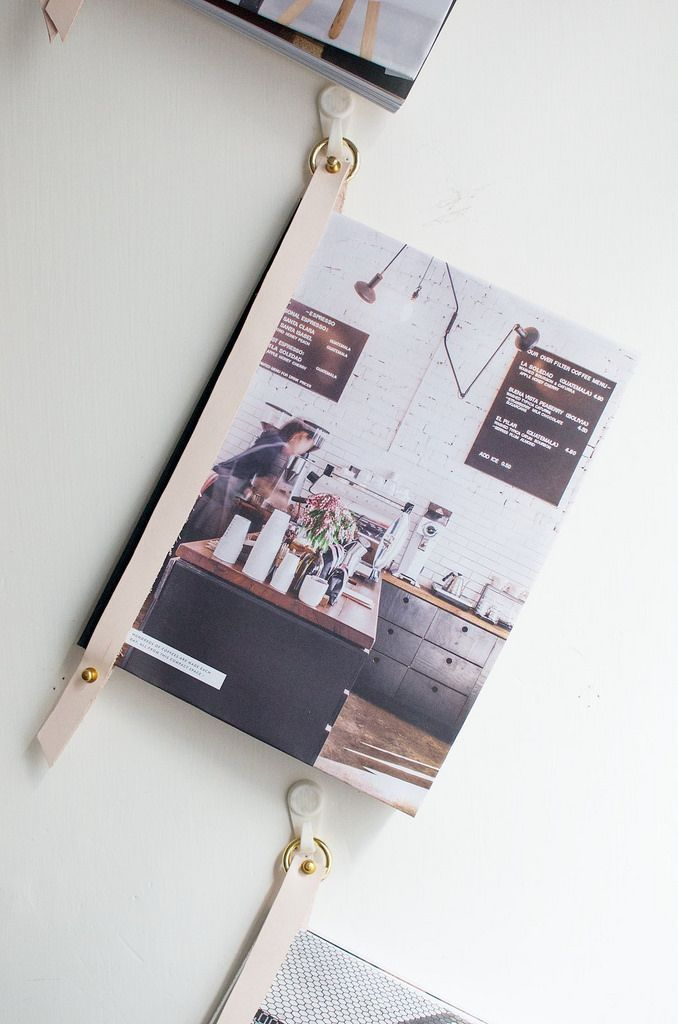 Create a beautiful wall display out of magazines or books using this DIY leather strap!