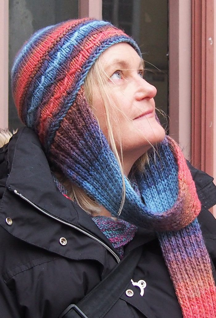 Free Knitting Pattern for Aviator Hat - Hat with attached scarf at ears for extra warmth. The brim features an easy slipped-stitch trellis pattern, garter stitch provides definition, and the top is in stocking stitch. The scarf is in simple 2 x 2 rib. Designed by Wei S. Leong. Pictured project by organisedknots