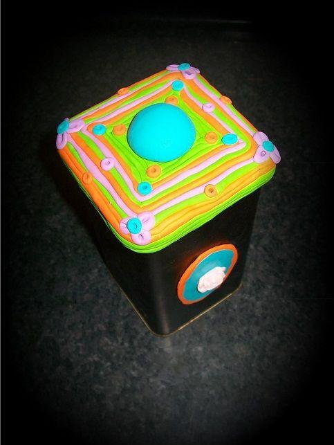handmade decoration with polymer clay of a tin coffee jar
