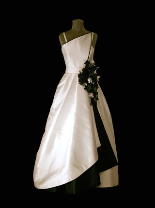 1994 - Worn by Queen Silvia of Sweden to Nobel Ceremony. This black and white creation made of zibeline has black flowers cascading down the side. Designed by Jacques Zehnder, Paris.