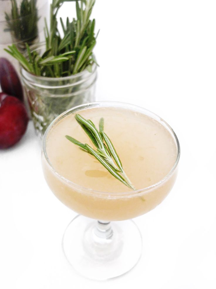 A fall light rum cocktail recipe that's perfect for Thanksgiving, Halloween, or any fall happy hour. The Plum and Rosemary Daiquiri made from light rum, plums, rosemary, sugar, and lime. // www.ElleTalk.com
