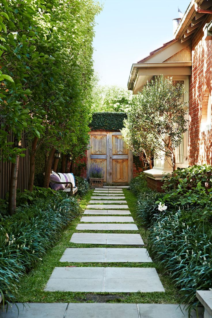 """Melinda and Simon landscaped the garden themselves. The teak doors were picked up in Java while on a furniture-buying trip. """"We knew they would make a fabulous feature in our garden,"""" says Melinda. """"It was well worth the effort to get them here."""""""