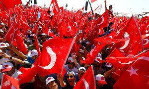 People wave Turkish flags at Istanbul rally