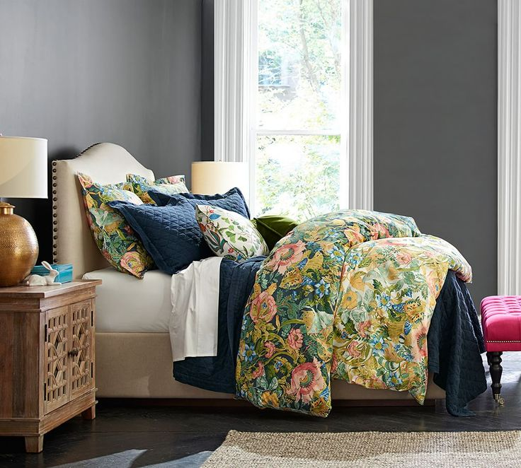 Take inspiration for your room's color palette from your bedding. Moody greys, serene taupes and vibrant blues all are pulled from the duvet.