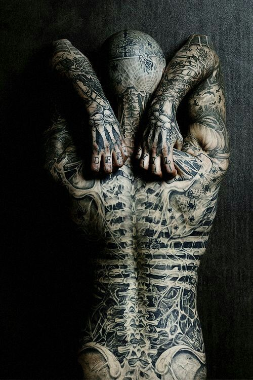 I think body art is a form of expression and people should be allowed to do whatever they choose to on their own bodies. This is Skeleton man's back tattoos.