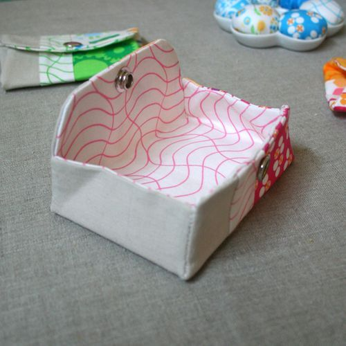 I got inspired by this tutorial to make a coin purse attached to the inside of a bi-fold wallet. I didn't use interfacing, just thick canvas fabric lined with thin cotton.