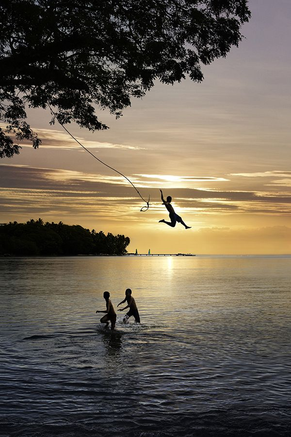 Rope swing into the ocean.