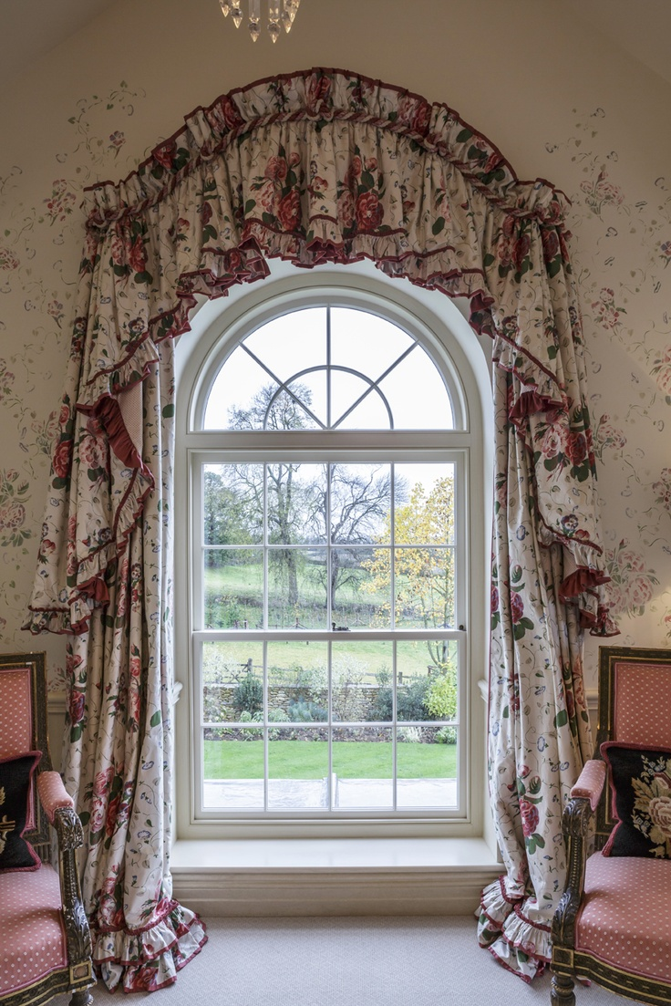 Quality sliding sash windows are still very much in demand ~ with a semi-circular head design making a special statement.
