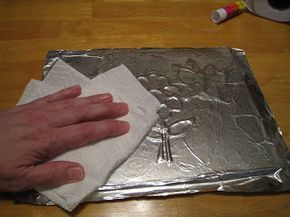 Tin foil art. Tacky glue on foam board. Dry. Cover in aluminum foil. Smooth down with tissue. Painting afterwards is optional.