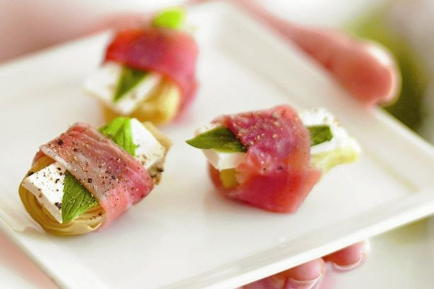 For sophisticated finger food in a flash, combine feta, artichoke and prosciutto.