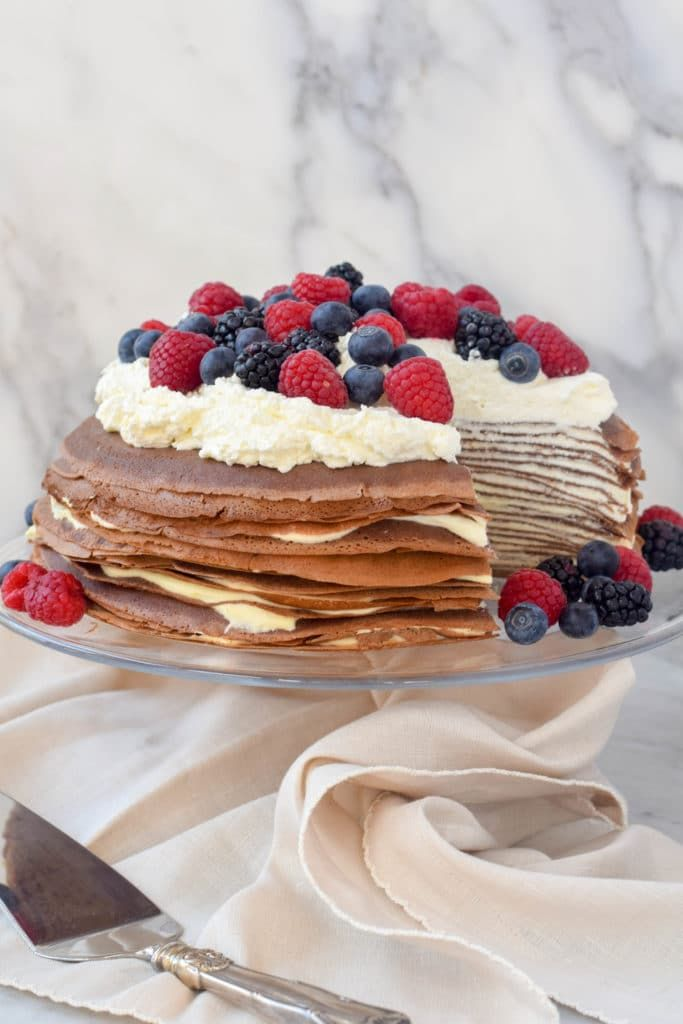 This gluten-free crepe cake is kosher for Passover (dairy) and a treat for all! Crepes are made with teff flour and filled with a orange-scented pastry. Step-by-step tutorial!