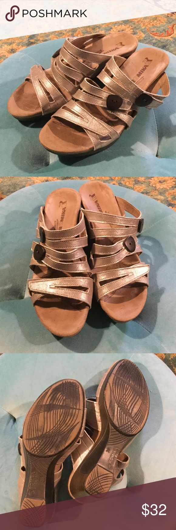 """Romika Waikiki Silver Leather Sandal Beautiful and extremely comfortable Romika leather sandals. All three straps on top of the foot are adjustable by strong Velcro, but it doesn't look like Velcro all. Suede footbeds are pillow soft. I only wore them 2 - 3 times because I don't normally wear heels. Heel is 2"""". These are a European size 39, but because of the Adjustable straps they fit me fine and I usually wear a 38. Feel free to make an offer and thanks for looking! Romika Shoes Sandals"""