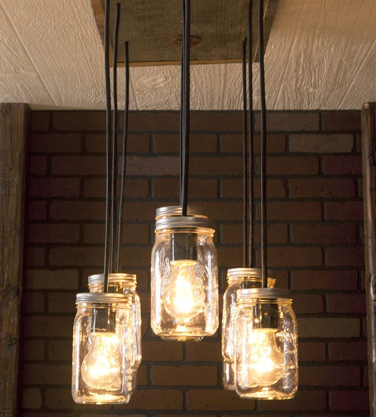 Crafted with reclaimed wood and clear Mason jars, this rustic light fixture adds a homey glow to any room. The rectangular canopy mounts flush to the ceiling and features 10 pendant lights, where the bulbs are encased in glass jars. Hanging at different lengths, the Mason jars can accommodate regular incandescent, fluorescent or Edison bulbs, just pick your favorite.