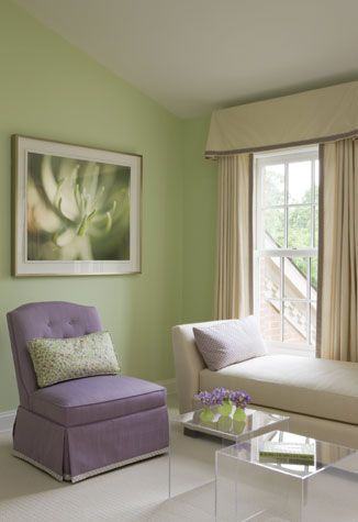 Decorated by Annette Hannon, this purple chair accents the color of the wall