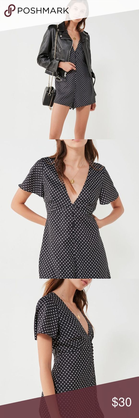 Polka Dot Silky Romper Brand new. Never Worn! Buttons all down the front. Perfect for going out or over tights. Urban Outfitters Dresses Mini