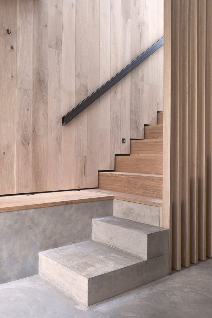 McLaren Excell contrasts smoked oak with white panelling for London home in a former office