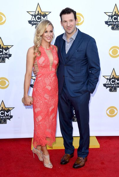 Tony Romo Photos Photos - Reporter Candice Crawford (L) and professional football player Tony Romo attend the 50th Academy Of Country Music Awards at AT&T Stadium on April 19, 2015 in Arlington, Texas. - 50th Academy Of Country Music Awards - Arrivals