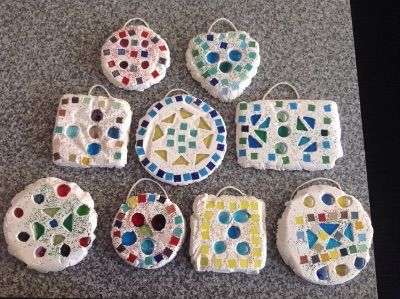 On Tuesday we made Roman mosaics.  First we used tiles and glass pebbles to make a design in the bottom of a tin which we had lined with cling film.  Then we poured plaster of Paris on top of the...