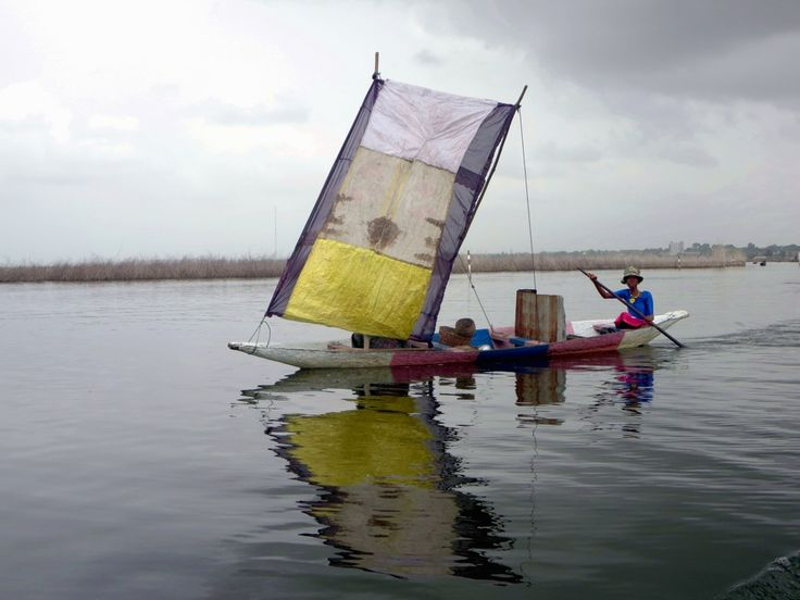 southpacifictravel:   Sailing canoes ply Lake...