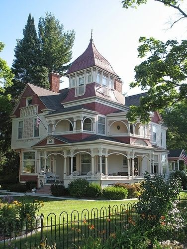 I usually do not love victorian houses, but I WANT that top room and all of those porches!